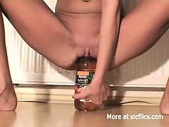 skinny-slut-fucking-huge-bottles
