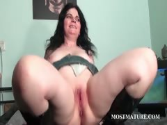 brunette-working-her-mature-pussy