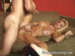 Busty shemale takes it in her big butt