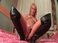 Mature In Leather Boots Doing Herself In Bed