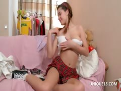 Schoolgirl Klara plays with round assets